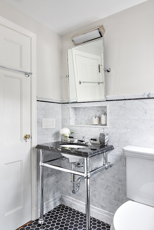 Stunning bathroom boasts upper walls painted pale gray and lower walls clad  in linear gray tiled wainscoting accented with black pencil tiles alongside  a 2. White and Black Laundry Room with Black Hex Tile Floor
