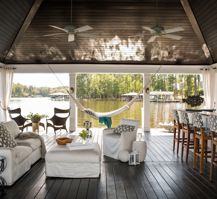 Boat Dock Transformed Into Lounge Features Vaulted Paneled Ceiling Dotted  With Ceiling Fans Over White Slipcovered Sofa And White Slipcovered Chair  Accented ...