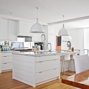Sleek White Kitchen Features White Flat Front Cabinets Paired With