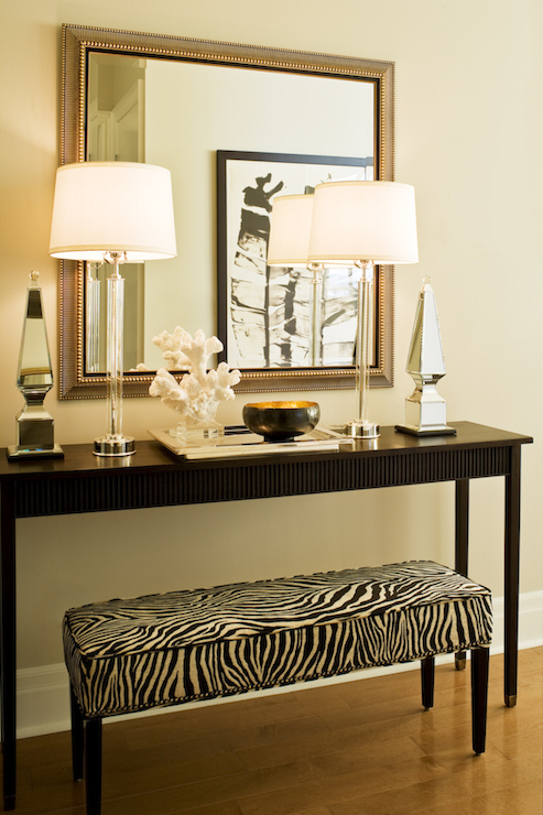 Zebra Ottoman Transitional entrancefoyer Elle Decor : rectangular zebra bench black console table foyer mirrored obelisks from www.decorpad.com size 493 x 740 jpeg 326kB