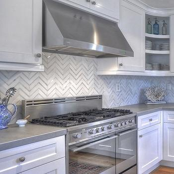 with zinc counters and a white and gray marble herringbone backsplash