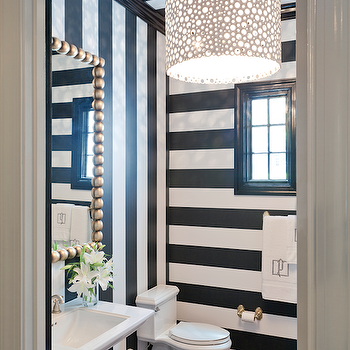 Powder Room With Black And Striped Walls