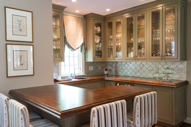 Brown Kitchen Island With Quartzite Countertops And Gray