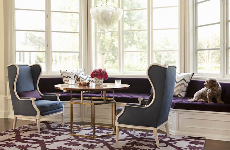 Chic Family Game Room Features A Bay Window Filled With Built In Curved Bench Covered Purple Velvet Tufted Cushions Facing Round Wood And Brass