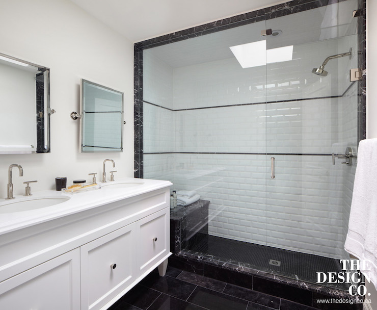 Contemporary Black And White Bathroom Boasts A White Double Washstand On  Legs Adorned With Black Knobs Topped With White Quartz Countertop Framing  His And ...