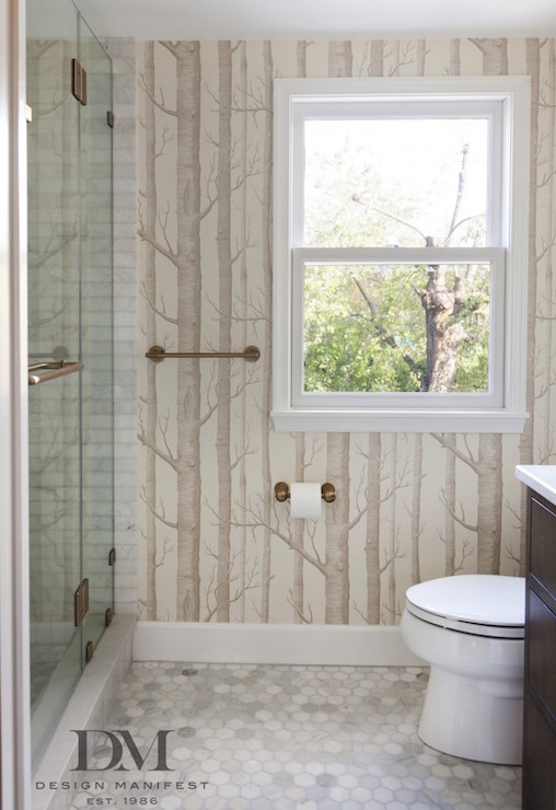Fabulous Bathroom Boasts Walls Clad In Cole Sons Woods Wallpaper Alongside A Seamless Glass Shower Accented With Brushed Bronze Handle Across From