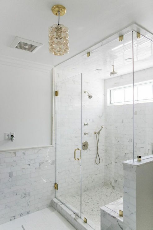 Bathroom With Marble Wainscoting And Marble Pencil Rail
