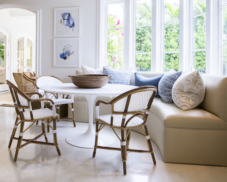 Bistro Breakfast Table Part - 21: ... Fitted With Window Situated Over A Beige Curved Banquette Lined With  White And Beige Ikat Pillows And Blue Print Pillows Facing A Saarinen Dining  Table ...