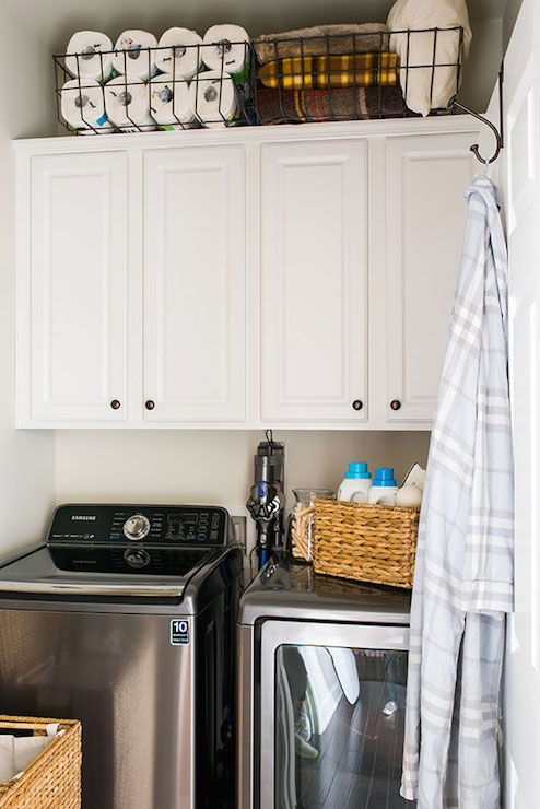 Superbe ... Room Features Wire Baskets With Household Goods Atop Side By Side  Cabinets Accented With Raised Panel Doors Suspended Over A Gray Washer And  Dryer.