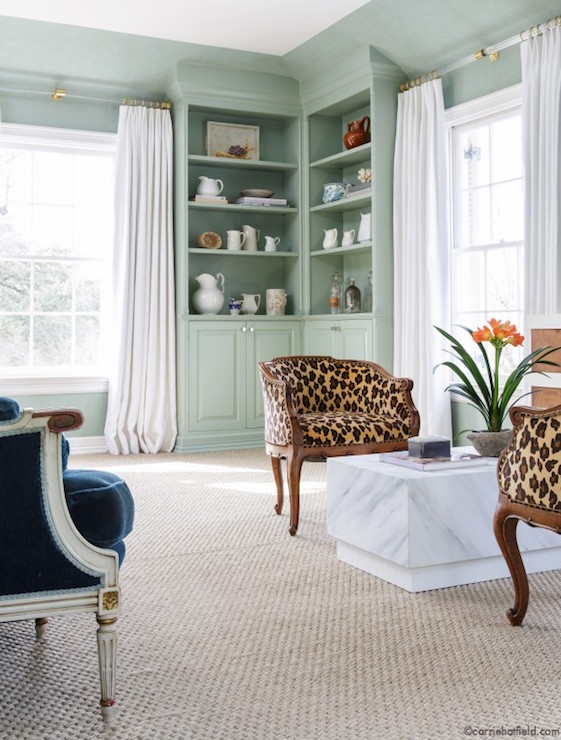 ... Area Boasts Built Ins And Walls Painted Sea Foam Green Flanked By  Windows Dressed In Pure White Curtains Hung High On Brass And Lucite Curtain  Rods.