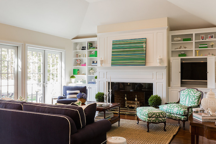Pivoting bookcase and tv cabinet transitional living room benjamin moore white dove for Hiding a tv in the living room