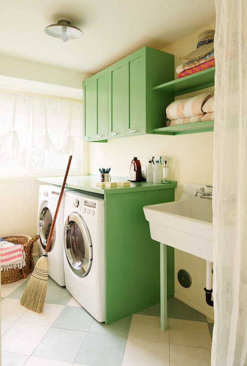 Charmant Lovely Laundry Room Features Kelly Green Cabinets Adorned With Cup Pulls  Suspended Over An Enclosed Washer And Dryer Under Green Countertop Beside A  Utility ...