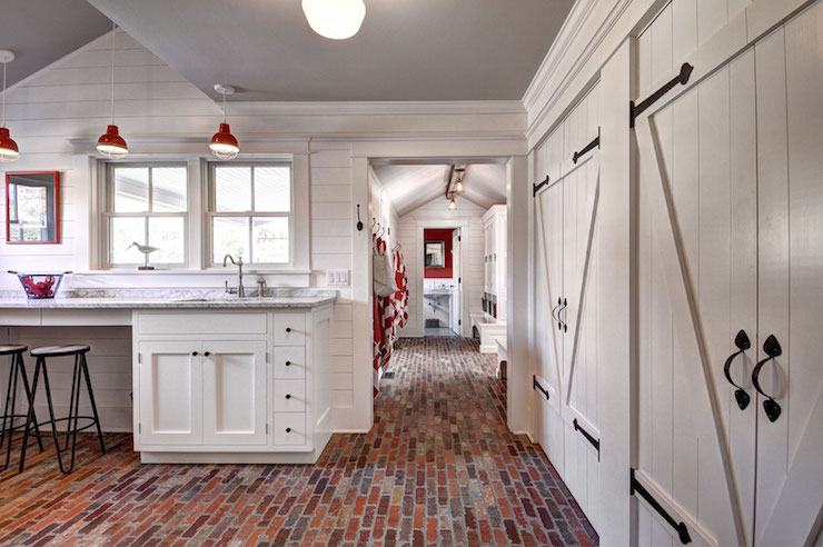 Laundry Room With Brick Floor