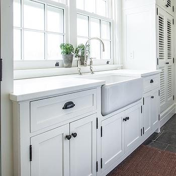 Farmhouse Laundry Sink : ... farmhouse sink and deck mount gooseneck faucet situated under windows