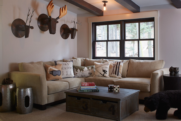 Country Cabin Living Room Features Ceiling Dotted With Dark Wood Beams