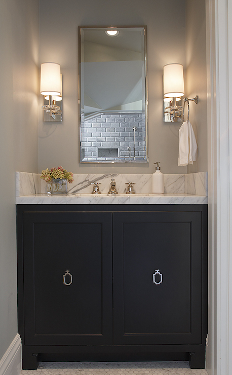 sophisticated bathroom features nook filled with a black washstand