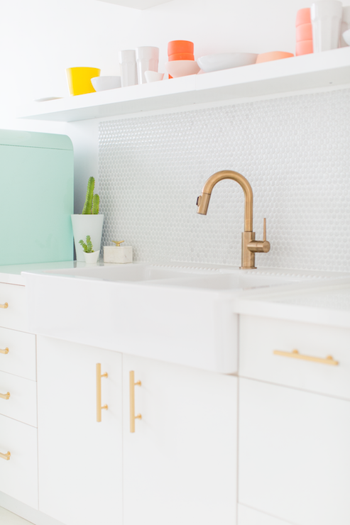 Lovely vintage kitchen features white base cabinets, Ikea Sektion, adorned  with brushed brass hardware, Lewu0027s Hardware 3-3/4-in Center-to-Center