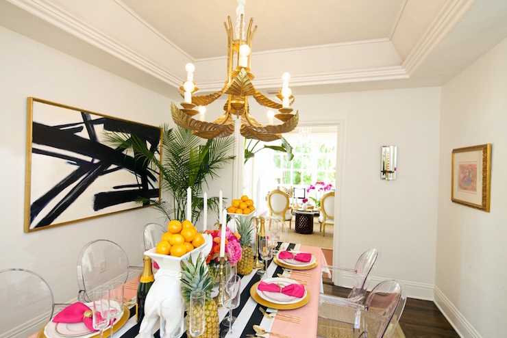 Dining Room With Tray Ceiling Dotted With A Gold Leaves Chandelier  Illuminating A Long Dining Table Draped In A Pink Tablecloth Topped With A  Black And ...