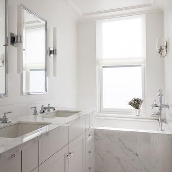 'Marble Bathtub Ideas' from the web at 'https://cdn.decorpad.com/photos/2015/02/17/m_marble-tub-white-shaker-bathroom-cabinets-sleek-white-bathroom.jpg'