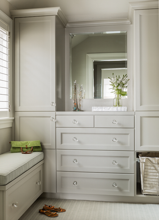 Gray Dressing Room Features Fray Walls Lined With A Gray Built In Bench  With Storage Drawer Which Doubles As A Window Seat Atop A Gray Stripe Rug.
