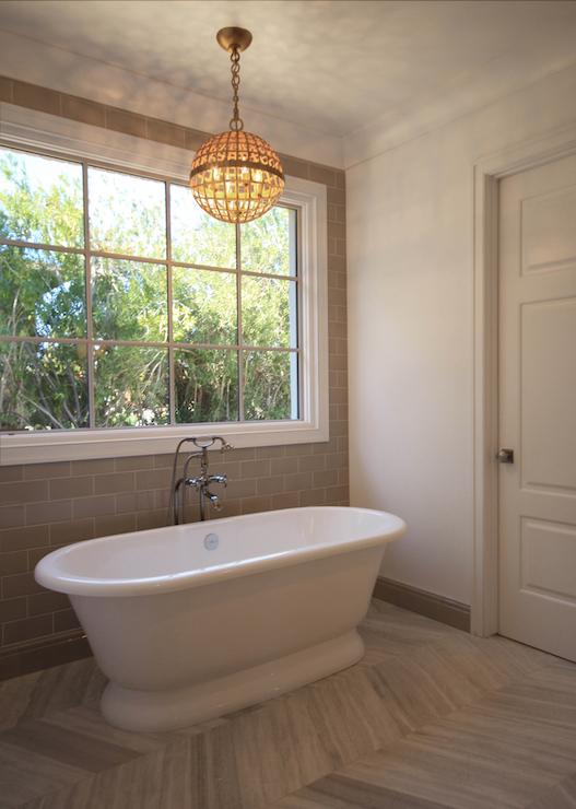 Gray chevron floor tiles transitional bathroom for Tub over old tub