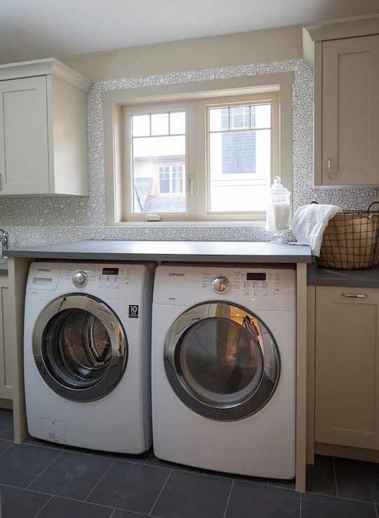 Laundry Room With Marble Herringbone Backsplash Tiles