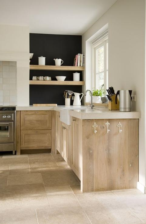 Amazing Lovely European Kitchen Features Lightly Stained Cabinets Fitted With White  Fleur De Lis Hooks Paired With Thick Cream Countertops Framing A Farmhouse  Sink ...