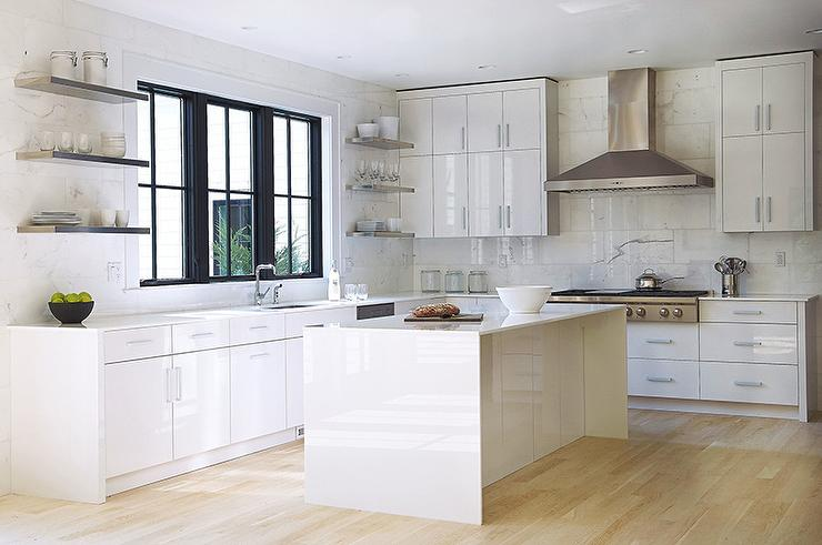 Modern Kitchen Features White Lacquered Cabinets Paired With White