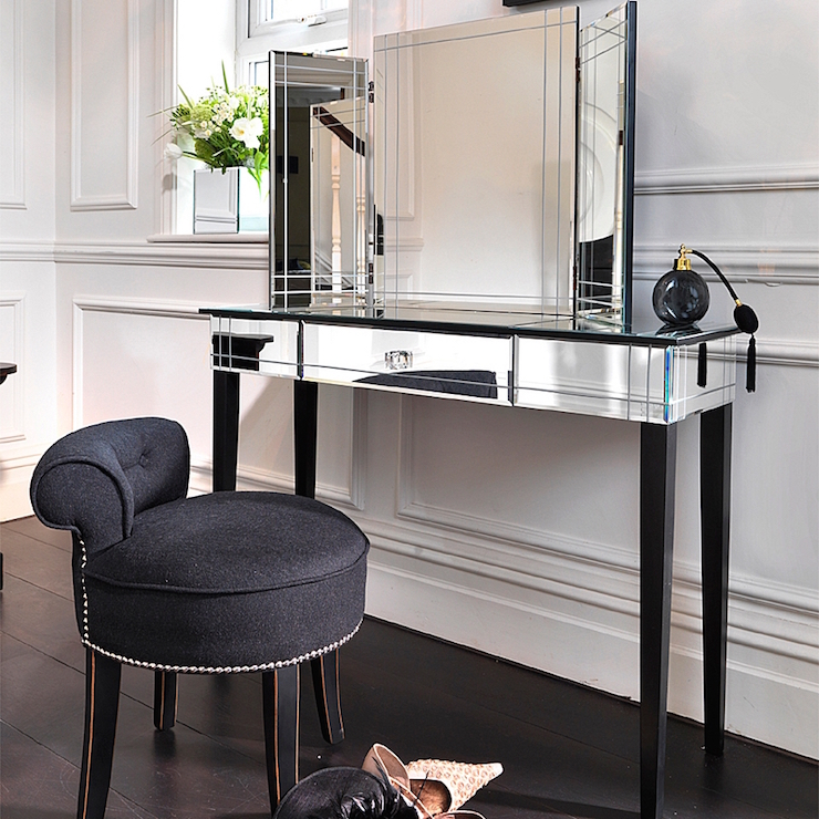 Gorgeous dressing room features walls clad in wainscoting lined with an art  deco mirrored dressing table topped with a folding vanity mirror paired  with a. Mirrored Makeup Vanity Design Ideas