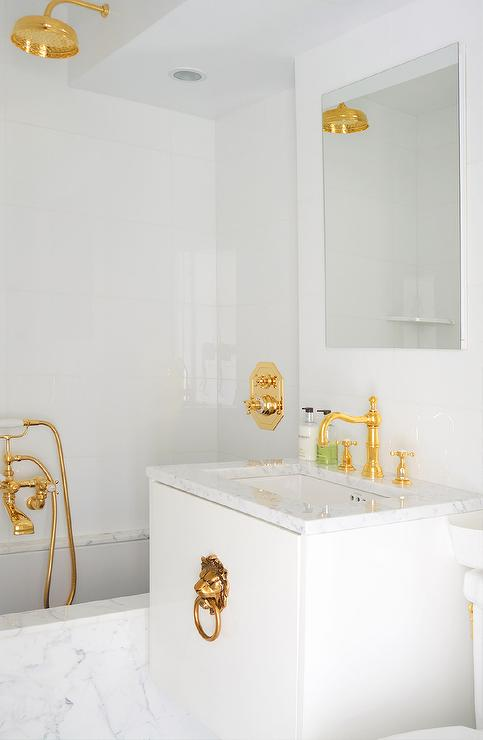 white bathroom with gold fixtures gold shower head gold bathroom