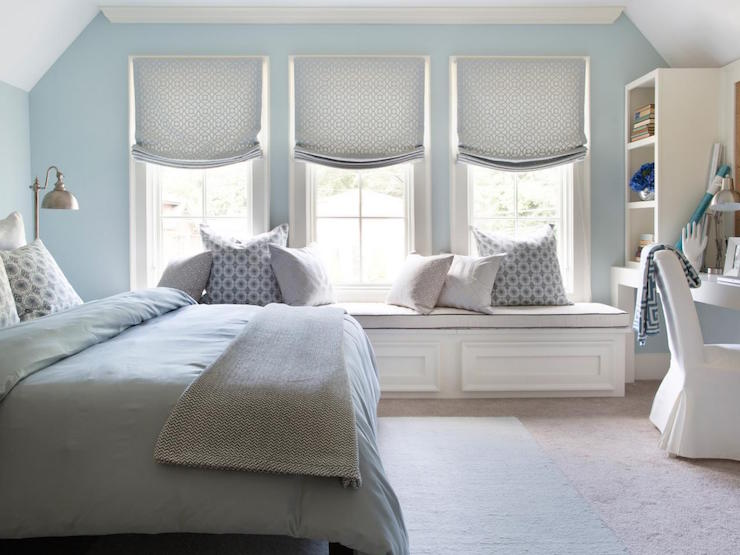 Brian Patrick Flynn - Blue and gray bedroom features blue walls lined with  a beige linen headboard with nailhead trim on bed dressed in blue bedding  and a ...