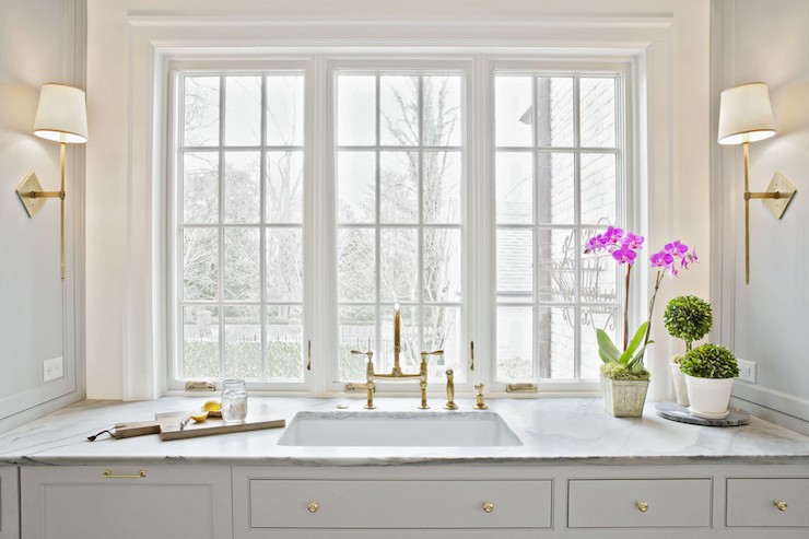 faucet adorned cortland cabinets brass design sconce framing countertops accented knobs cabinet gold beautiful ideas paired porcelain and features marble kitchen gray with deck a sink search white