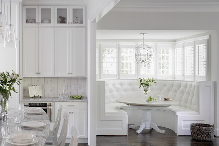 Amazing White Dining Nook Is Filled With A Tufted Curved Banquette Horseshoe Shaped Doubling As Window Seat Facing Round