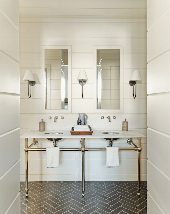 herringbone bathroom floor. Gorgeous bathroom features shiplap clad walls lined with a double washstand  three legs topped white marble fitted his and her sinks under Brick Floor Design Ideas