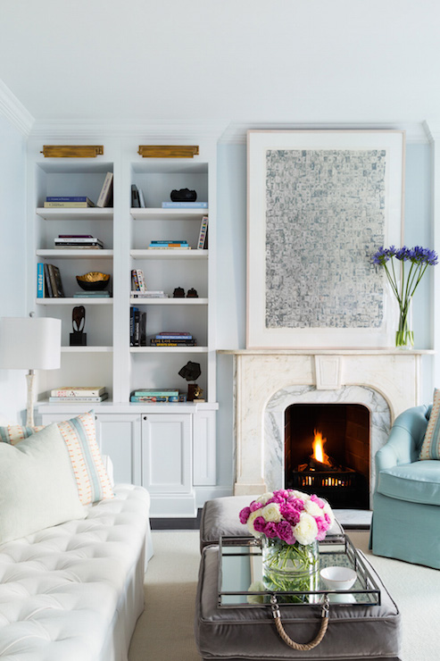 Amazing Blue Living Room Features Pale Walls Lined With Built In Bookcases Illuminated By Brass Picture Lights Next To A Marble Fireplace Mantle