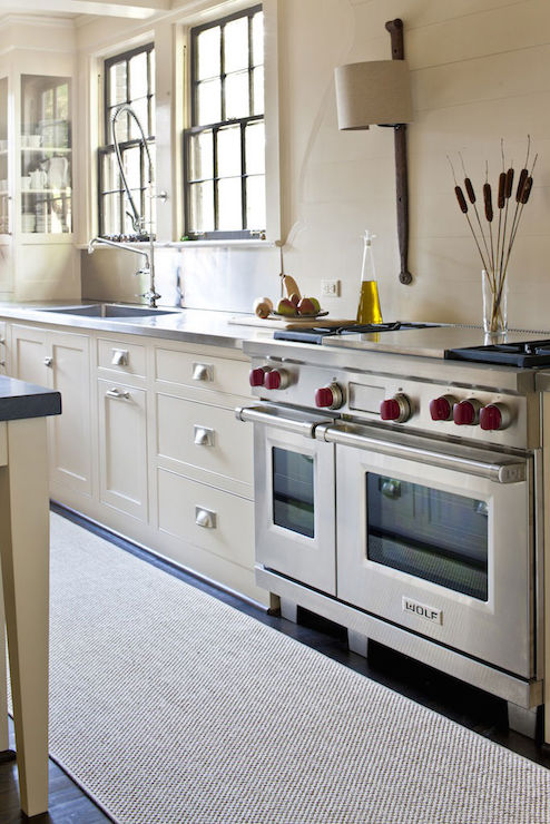 Cream Cabinets With Stainless Steel Countertops