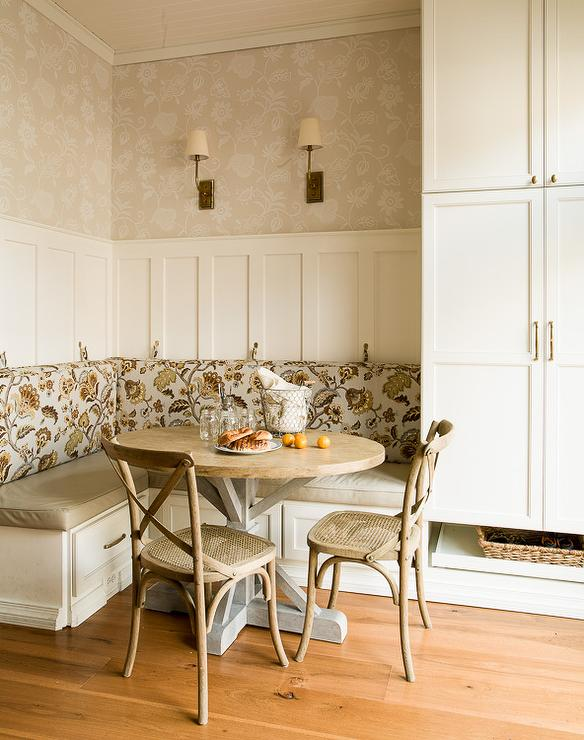 Cottage Breakfast Nook Features An L Shaped Built In Banquette With Storage Drawers Adorned Taupe Vinyl Bench Cushions And Blue Floral Back