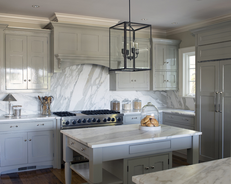 gray kitchen features glossy gray cabinets paired with statuary marble