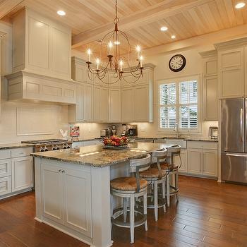 White Kitchen Island with Gray Granite Countertops ...