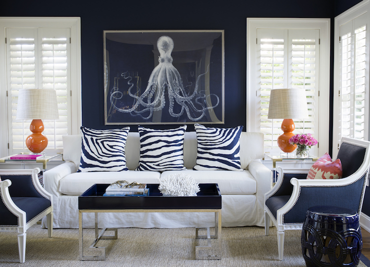 White And Navy Living Room With Orange Accents