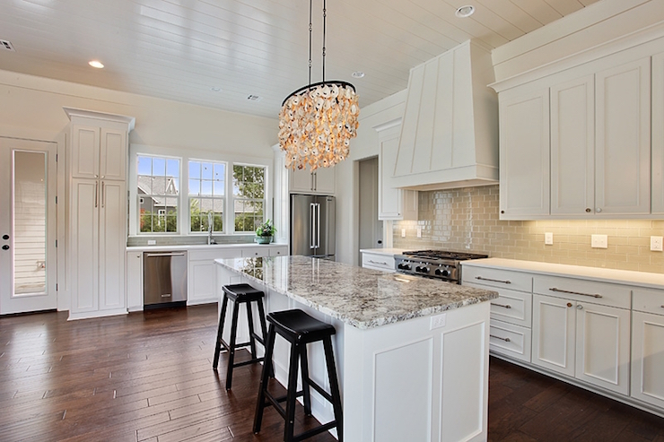 White Kitchen Island With Gray Granite Countertops Transitional