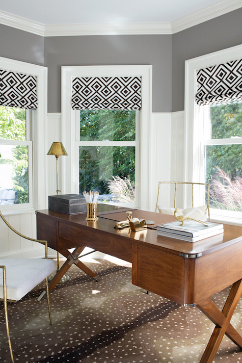 campaign desk on antelope rug - transitional - den/library/office