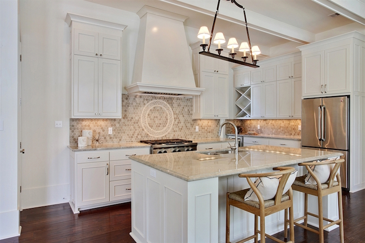 and beige kitchen features creamy white cabinets paired with cream