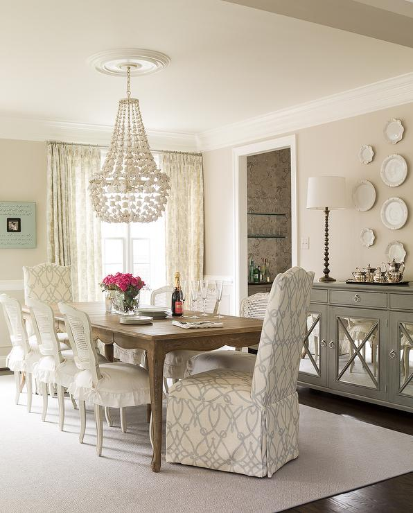 Beautiful Dining Room Features A French Dining Table Lined With White Cane  Back Dining Chairs With Skirted Seat Cushions As Well As Slipper Captain  Dining ...