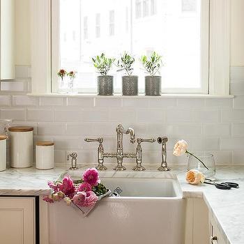 Ivory Kitchen Cabinets With Beveled Subway Tile Backsplash