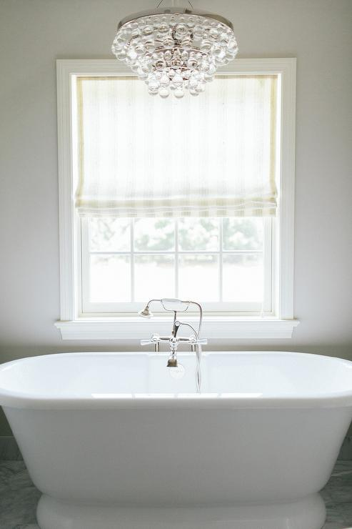 Robert Abbey Bling Chandelier Over Tub view full size. Window Above Tub Design Ideas