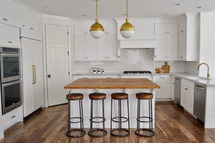 Beautiful White Kitchen Features A Pair Of Small Brass