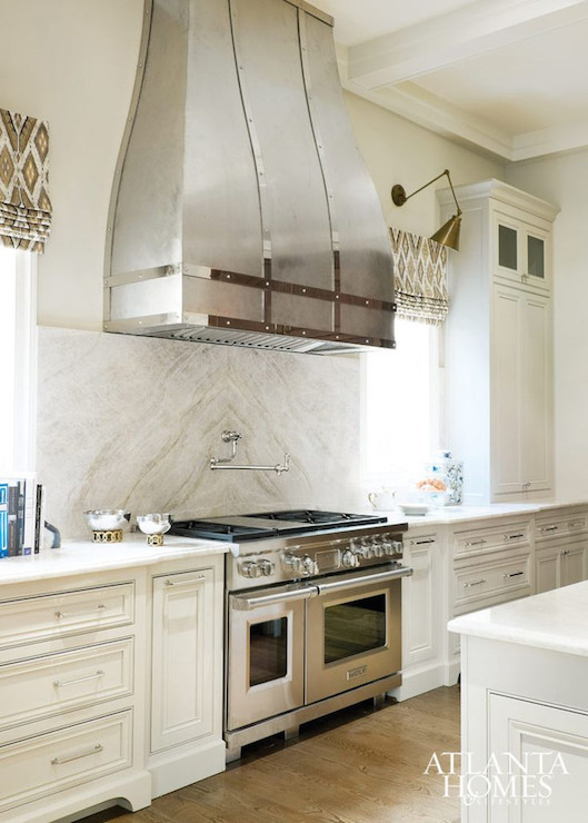 White Kitchen Hood kitchen hood between windows design ideas