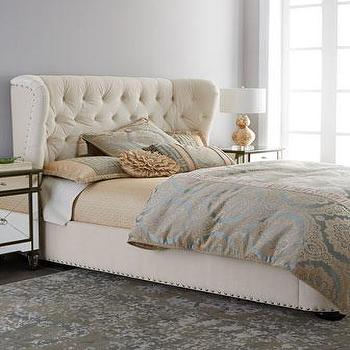 cream button all around tufted upholstered bed