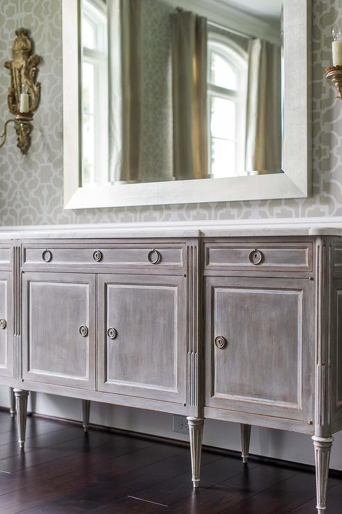 French Dining Room Features Upper Walls Clad In Gray Trellis Wallpaper And Lower Wainscoting Lined With A Distressed Sideboard